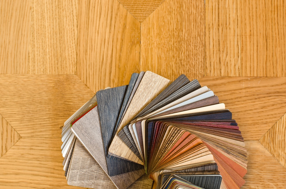 Color samples of wood floor on brown parquet background.